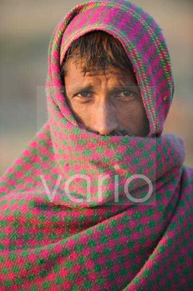 Indian man wrapped in a blanket
