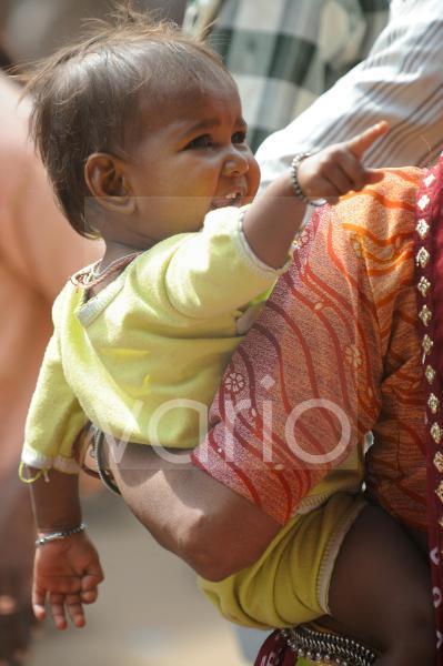 Indian child between the mother s hands
