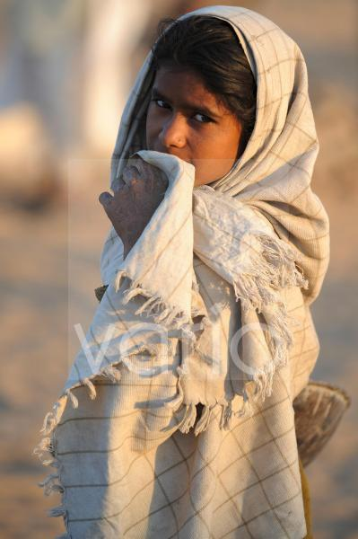 Indian girl wrapped with blanket