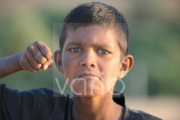 Funny indian boy give punch