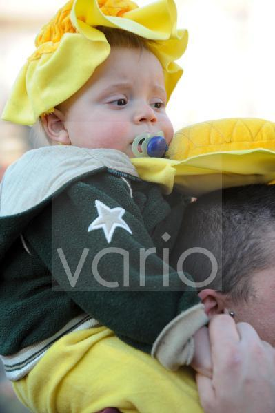 Little cute boy in Carnival festival in Rome