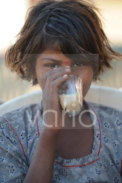 Indian girl drink milk tea