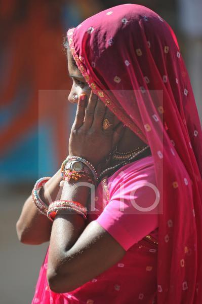 Cute woman with violet sari