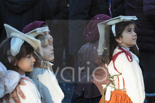 Italian child dressed with traditional costume in Rome carnival festival