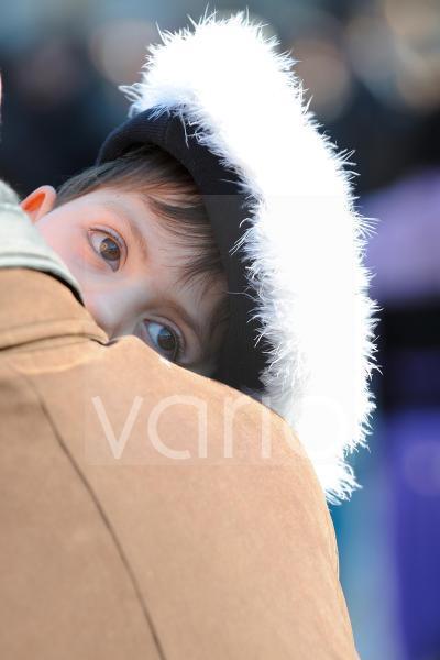 Cute italian boy looks in a vacuum