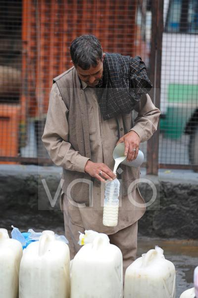 Indian man sell milk in the market