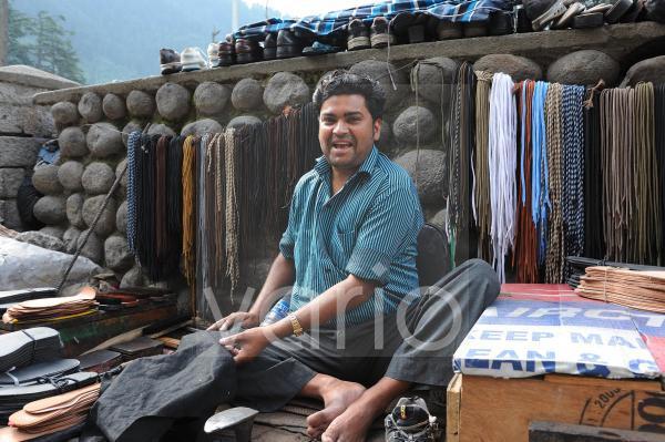 Shoemaker in himalayan market