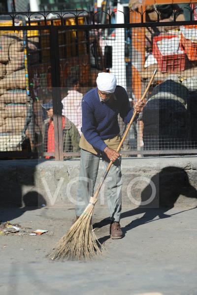 Man sweeps the street