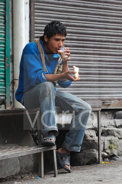 Indian boy eat breakfast