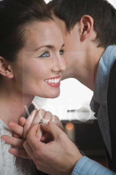 Portrait of newly engaged couple, close-up