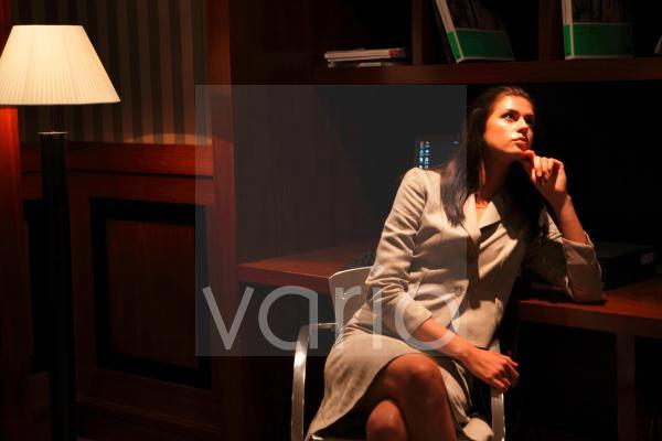 Businesswoman contemplating with hand on chin