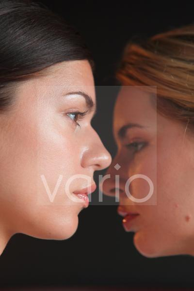 Close-up of a two beautiful young women contemplating