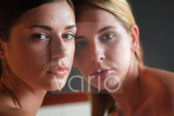 Portrait of a two beautiful young women contemplating