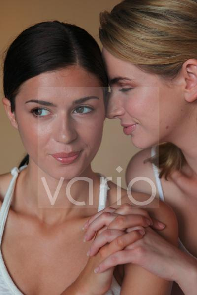 Close-up of a lesbian couple holding hands