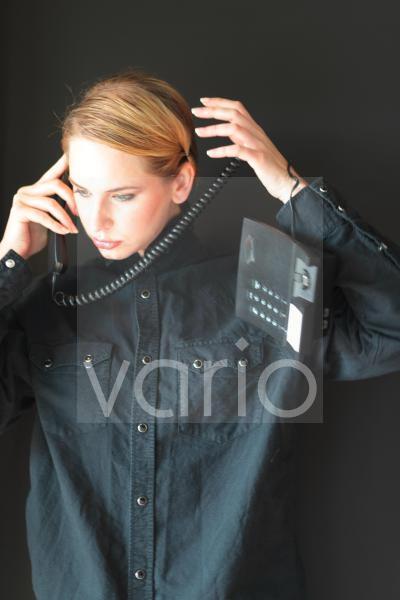 Beautiful young woman using telephone
