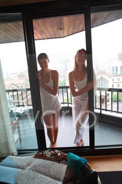 Portrait of a beautiful lesbian couple standing in balcony