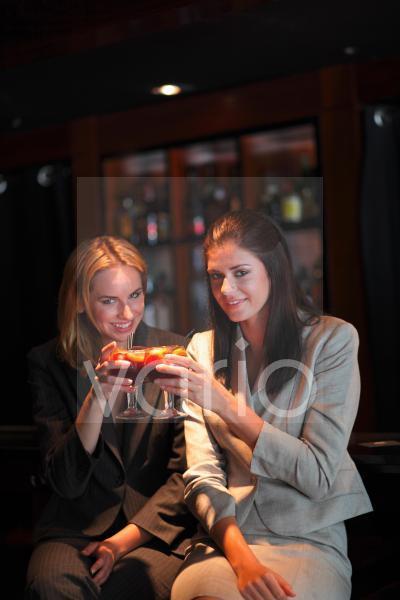Portrait of a gorgeous lesbian couple having drinks