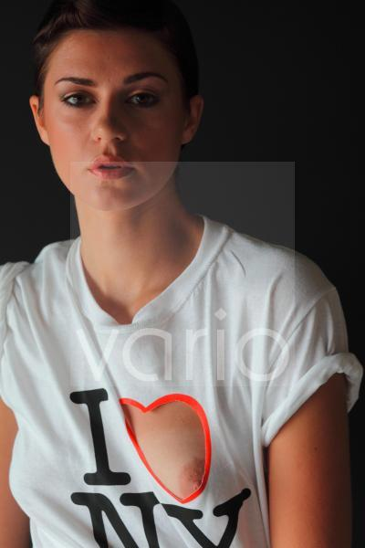 Portrait of sexy young woman with t-shirt torn around breast