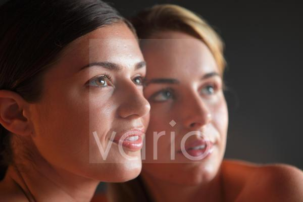 Close-up of two beautiful curios young women
