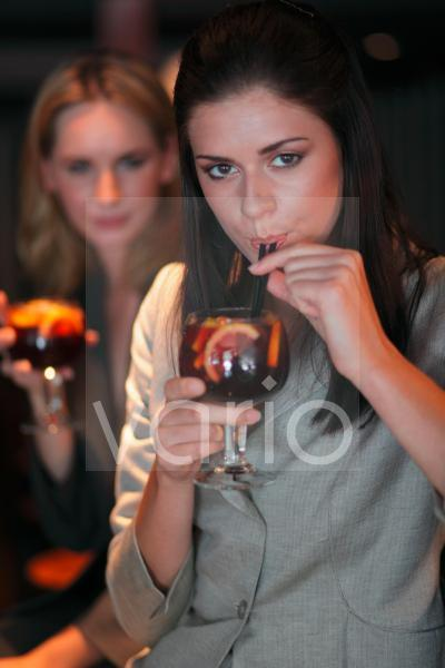 Two gorgeous young women having drinks