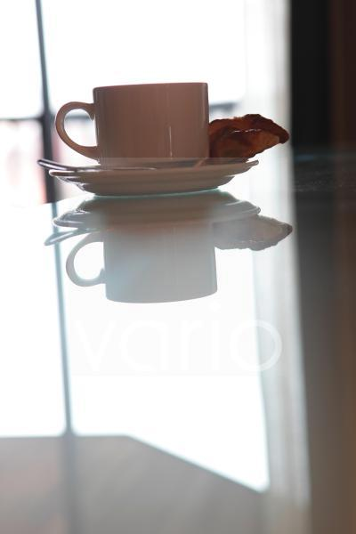 Cup and saucer with snack