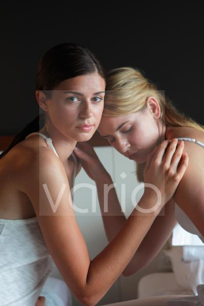 Close-up of a lesbian couple contemplating
