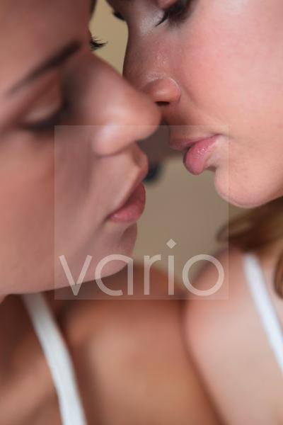 Close-up of a lesbian couple about to kiss