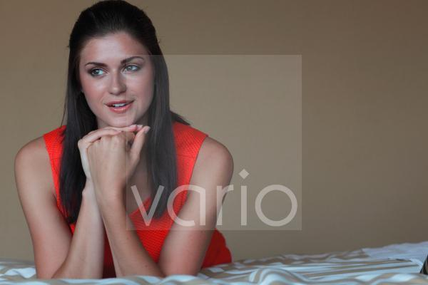 Beautiful young woman with hand on chin