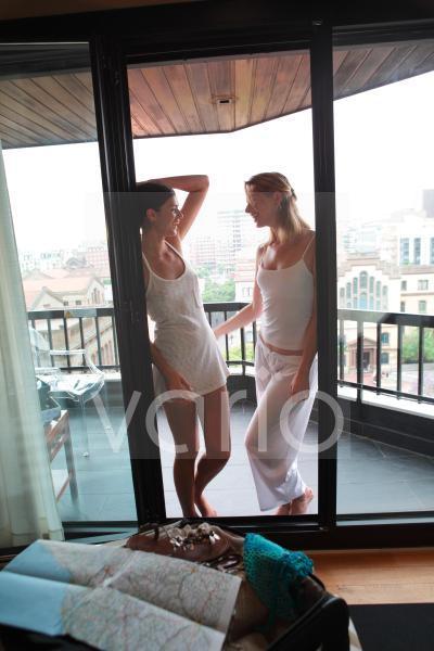 A happy lesbian couple enjoying at balcony