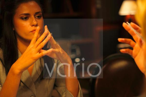Close-up of a businesswoman contemplating