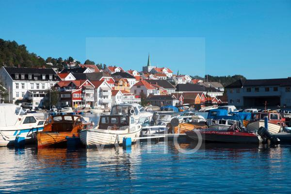 Local boats crammed into harbour at Kragero, South Norway, Scandinavia, Europe