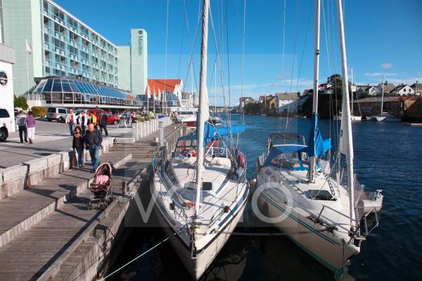 Yachts moored along harbour wall, Haugesund, West Norway, Scandinavia, Europe