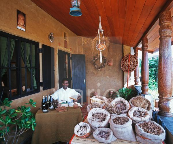 Ayurvedic doctor in displaying herbal medicines, Sri Lanka, Asia