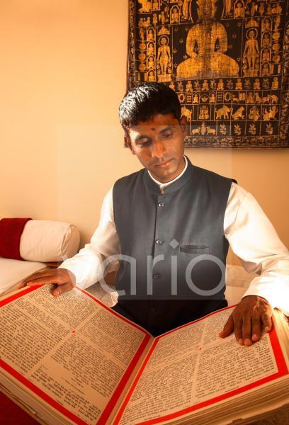 Man reading Vedic texts, Tehri-Garhwal, Uttaranchal, India, Asia