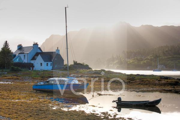 Early morning view of Loch Carron with sunlight bursting over distant hills, Plockton, Kintail, Highlands, Scotland, Europe