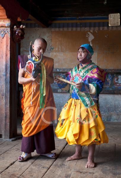Buddhist monk in colourful costume waiting to take part in traditional dance at the Tamshing Phala Choepa Tsechu, near Jakar, Bumthang, Bhutan, Asia
