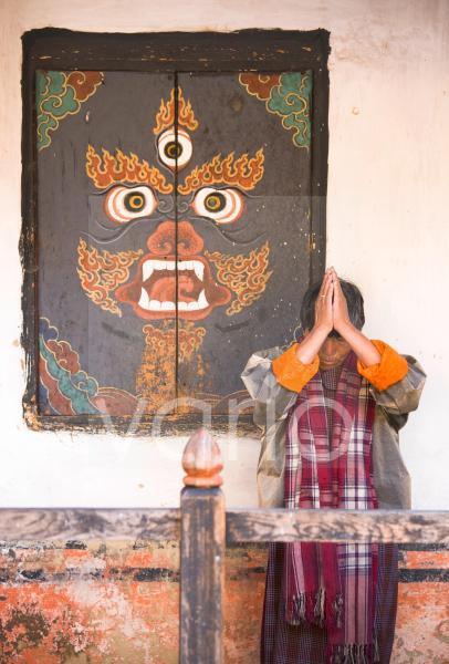 Woman praying at Jampey Lhakhang, a 7th century temple, near Jakar, Bumthang, Bhutan, Asia