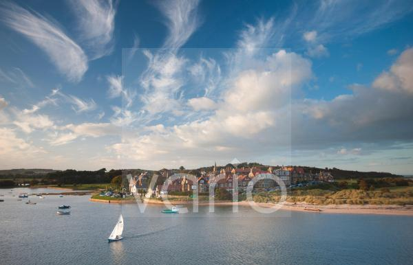 Alnmouth village and the Aln Estuary viewed from Church Hill on a calm late summer's evening with a dramatic sky overhead, Alnmouth, near Alnwick, Northumberland, England, United Kingdom, Europe