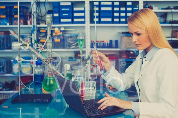 Female chemist working on a laptop