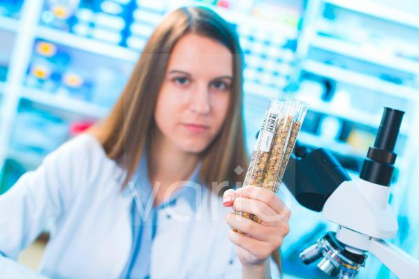 Lab technician with legumes