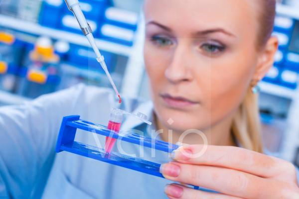 Scientist with an eppendorf tube