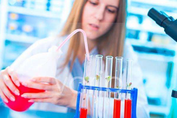 Female biologist squeezing liquid