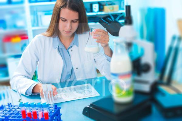 Scientist holding a glass beaker