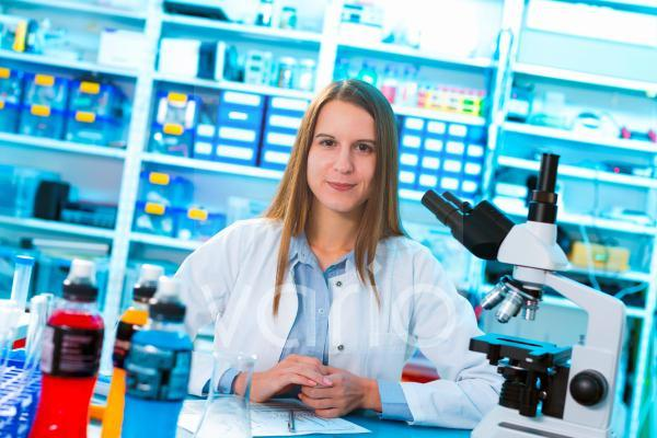 Scientist in lab with microscope