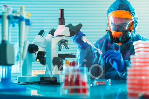 Person working in microbiology lab