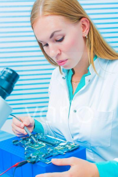 Lab assistant testing printed circuit