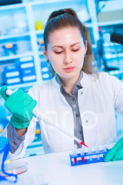 Scientist using pipette