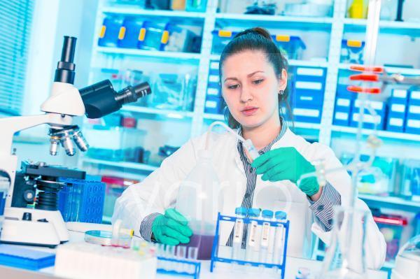 Scientist testing samples in lab
