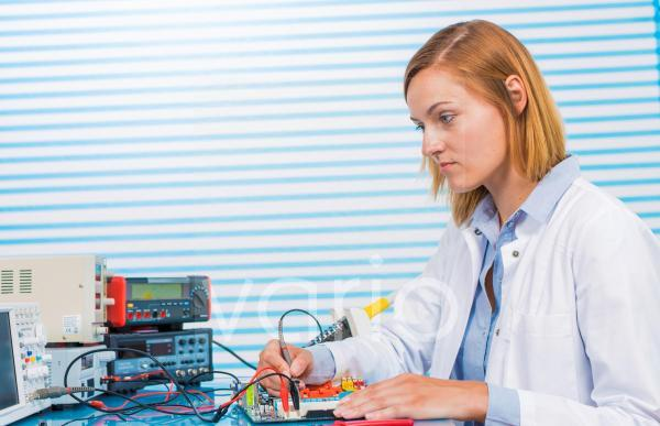 Female electrical engineer working in lab