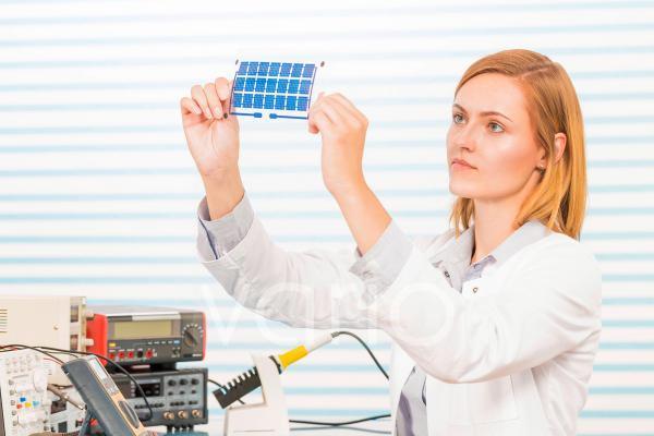 Technician holding thin film solar cells